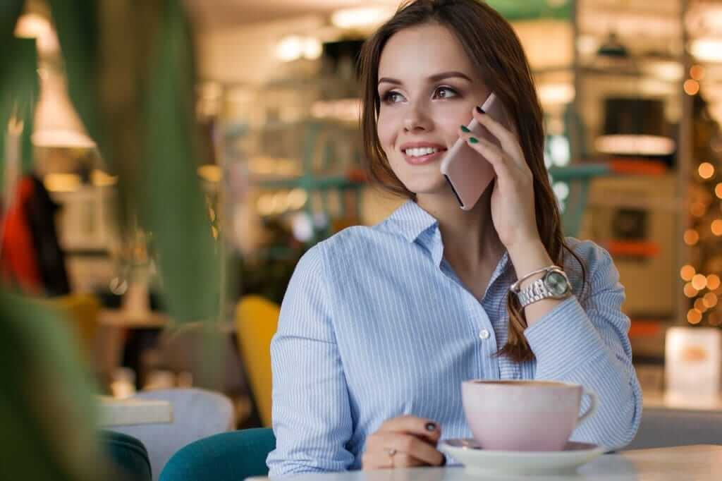 women using mobile signal booster